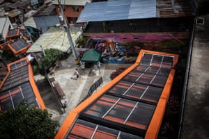 Graffiti at the bottom of one of Comuna 13's orange-roofed escalators, built in 2011 to connect the hilly area to the rest of Medellín