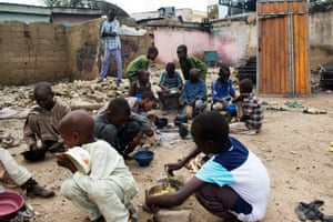 A group of orphaned children scrape by in the streets of Maiduguri.