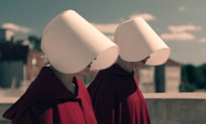 Offred and Ofglen in The Handmaid's Tale.