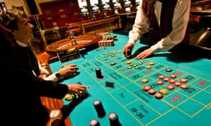 People gambling at roulette table in an Italian casino.