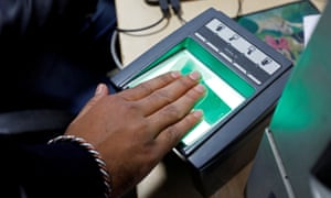A woman goes through the process of finger-scanning for the Aadhaar system at a registration centre in Delhi.