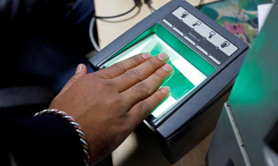 A woman goes through the process of finger scanning for the Aadhaar database system in New Delhi