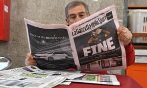 A man reads Italian sport newspaper Gazetta dello Sport