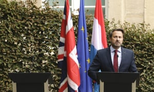 Xavier Bettel addressing the media next to an empty lectern intended for Boris Johnson.