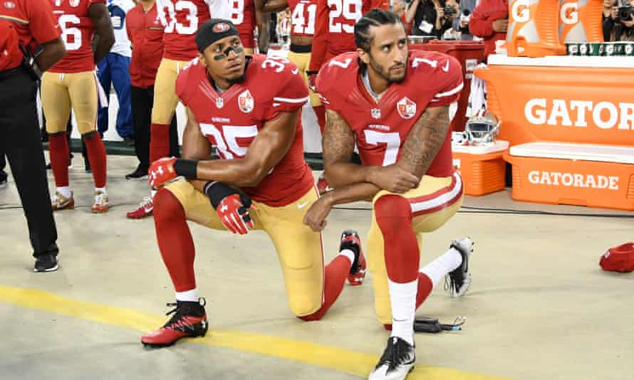 Colin Kaepernick and Eric Reid kneel in protest during the US national anthem in 2016.