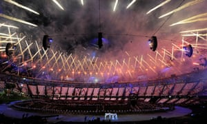 Fireworks light up the London sky as the Olympic flag is carried round the stadium during the 2012 opening ceremony.