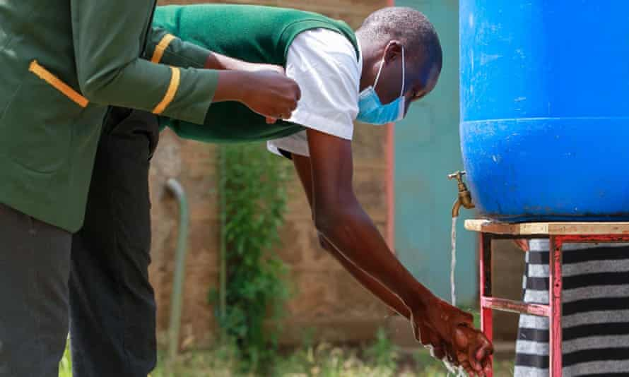 A Kenyan school student washing his hands: water is vital protection against Covid-19, but 4 billion people face severe water scarcity.
