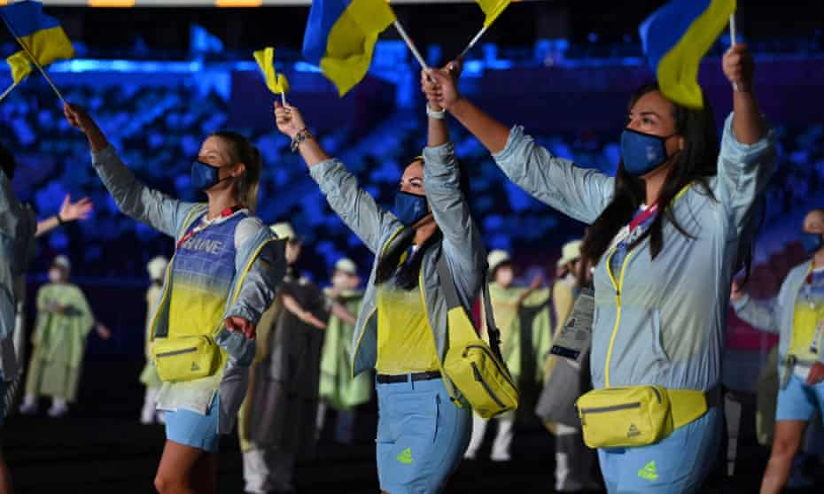 Members of Ukraine's delegation parade during the opening ceremony of the Tokyo Olympics