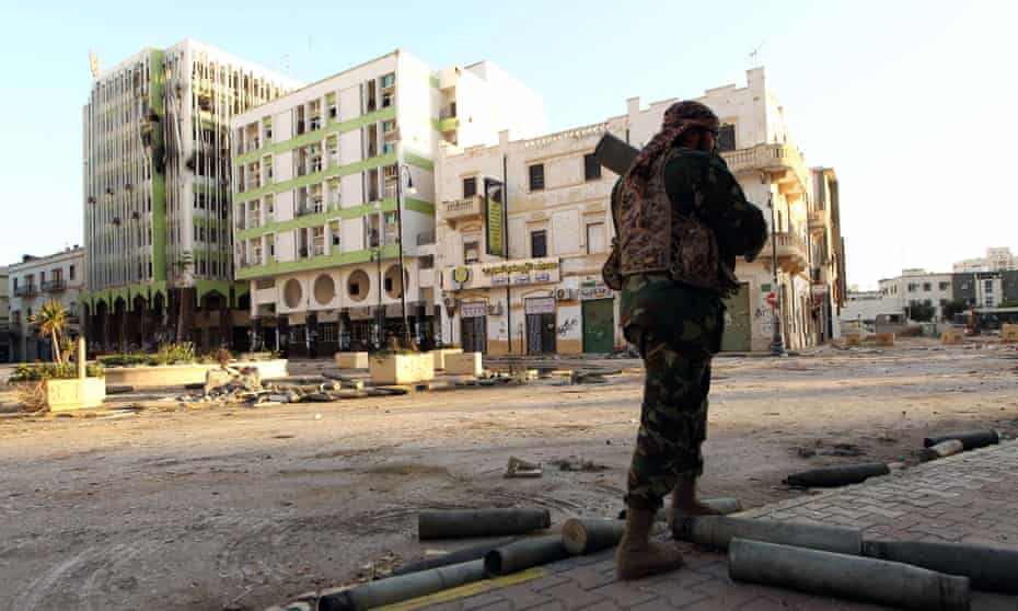 A Libyan soldier, loyal to Libya's internationally recognised government, patrols a street in Benghazi.