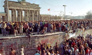 November 1989: Berliners congregate near Brandenburg Gate to celebrate the fall of the wall