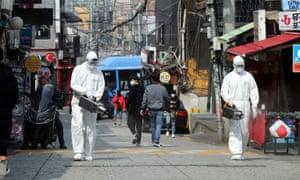 Quarantine workers spray disinfectant in Itaewon neighbourhood