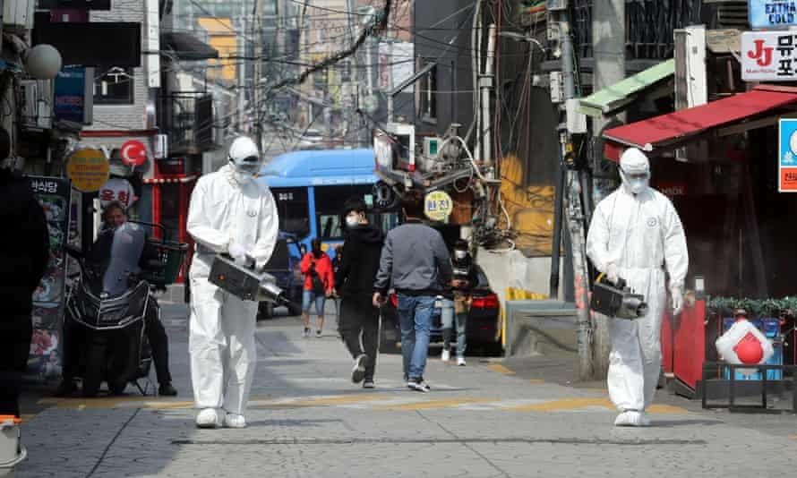 Quarantine workers spray disinfectant in Itaewon neighbourhood