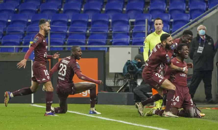 Aaron Leya Iseka celebrates after scoring the winner for Metz against Lyon.