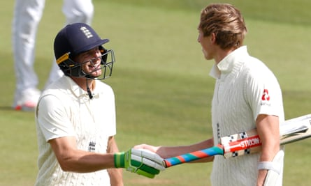 Jos Buttler and Zak Crawley shake hands at lunchtime after batting through the morning session of the second day against Pakistan at the Rose Bowl.