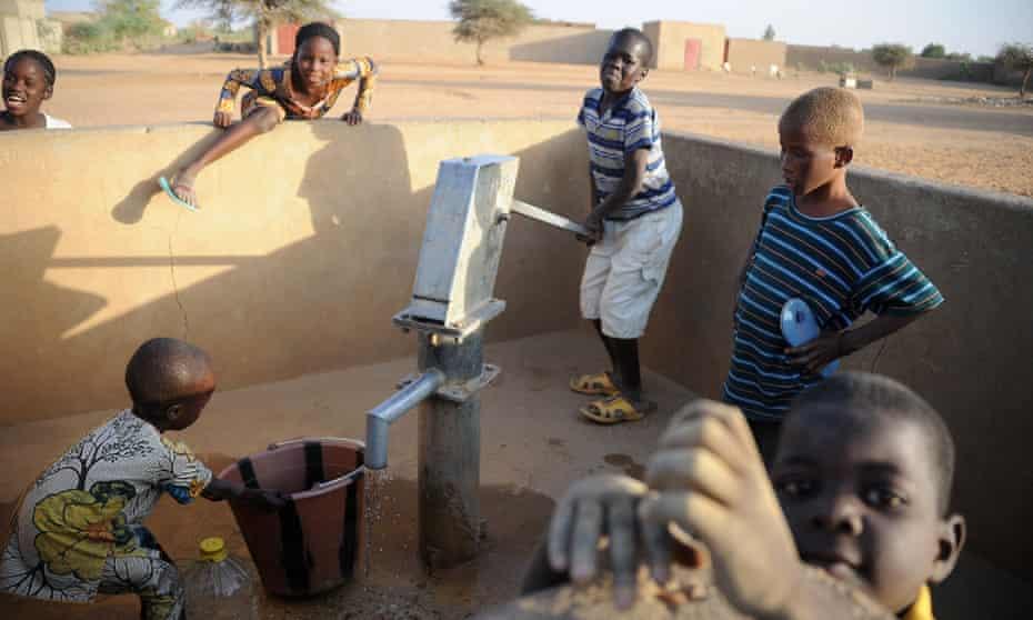 Malian children pump water in northern Mali's city of Gao.