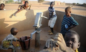 Malian children pump water in northern Mali's city of Gao. Brussels today announced a major international conference on the country's future.