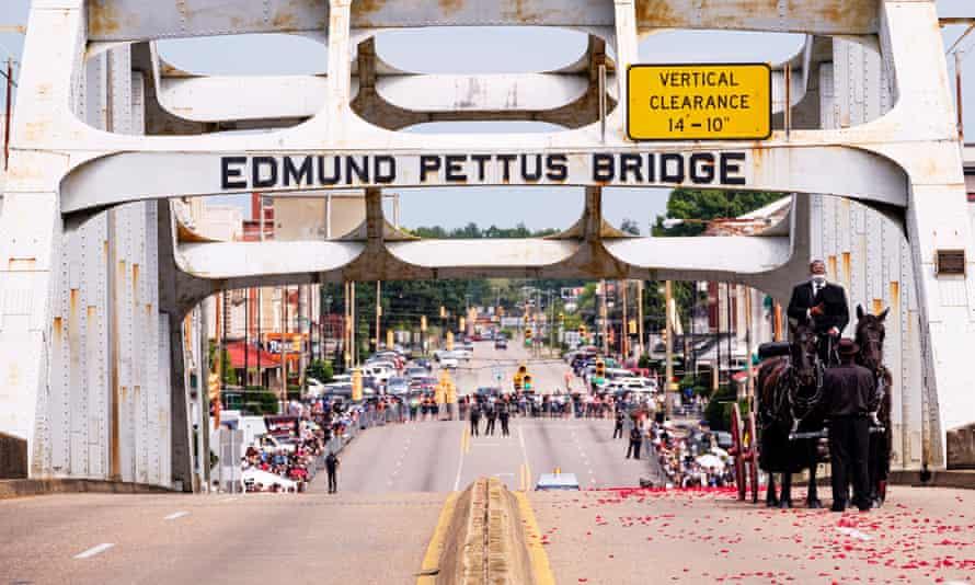 The funeral procession for the civil rights leader and Democratic representative John Lewis crosses the Edmund Pettus Bridge in Selma, Alabama.