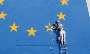 Banksy artwork painted on a former amusements arcade near Dover's ferry terminal showing an EU flag with a workman chipping away one of the stars.