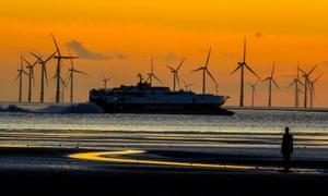 A ship passes a windfarm