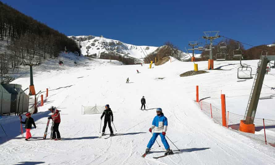 Skiers on a slope at Roccaraso, Italy.