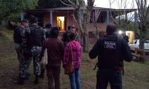 Police outside the gang's hideout in Monte Bonito on the outskirts of Pelotas.