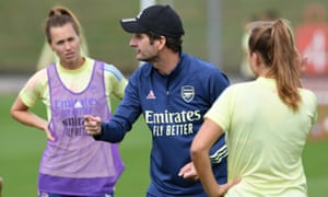 Arsenal's head coach, Joe Montemurro, speaks to his players as they prepare for their Champions League quarter-final against Paris Saint-Germain on Saturday.