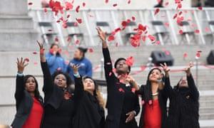Members of London Community Gospel Choir throw poppies in Trafalgar Square