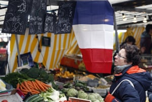 A French flag is displayed at the market Boulevard Richard Lenoir near the Bataclan in Paris, France