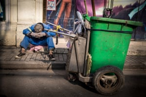 Street CleanExhausted street cleaner in Shanghai Photograph: Rob Smith/GuardianWitness