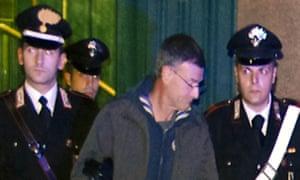 Massimo Carminati accompanied by police in Rome in 2014.