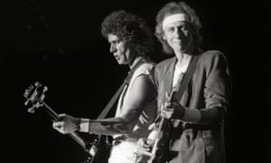 Dire Straits' John Illsley, left, with Mark Knopfler on stage in 1985