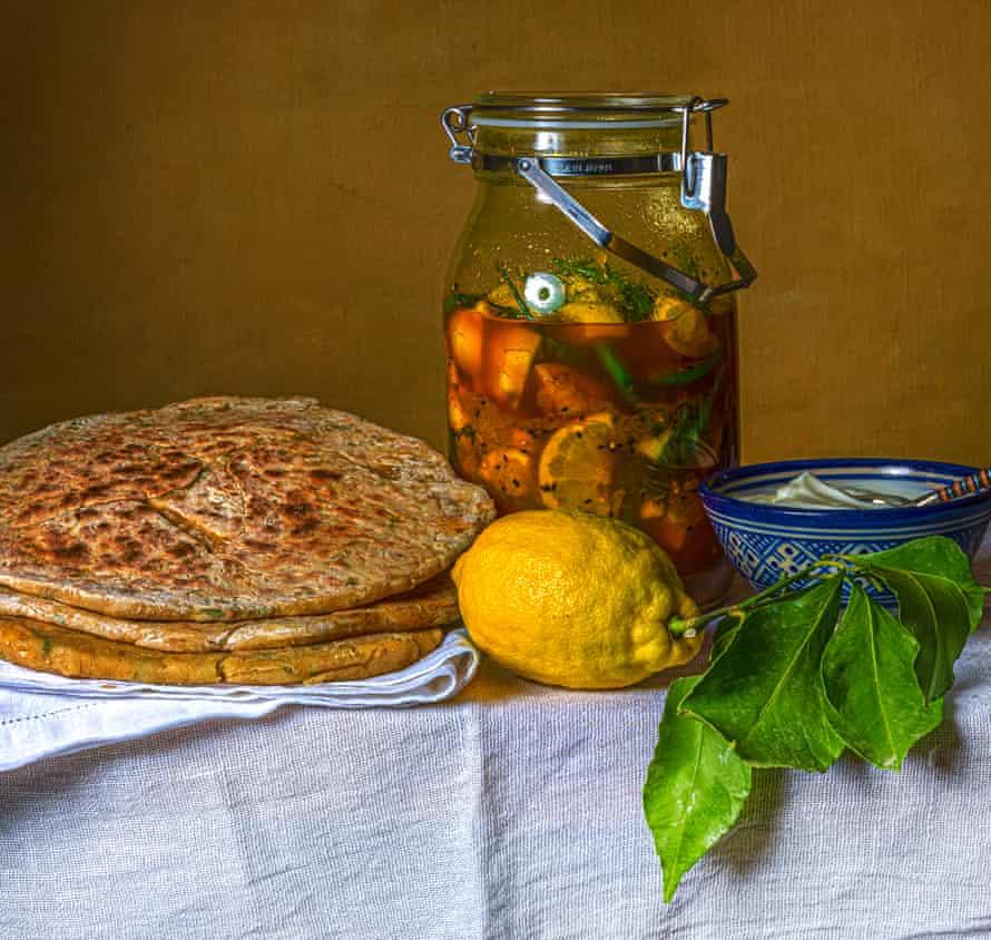 Dal and fenugreek parathas with lemon pickle and yogurt.