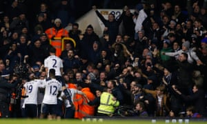 Tottenham's Dele Alli celebrates scoring their first goal with team-mates and the joyous Spurs fans.
