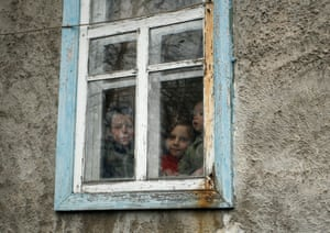 Local children look through a window of their home in Zaytseve, a village in the war-torn Donetsk area of Ukraine. Heavy fighting between pro-Russian rebels and the Ukrainian army still occurs in the region.