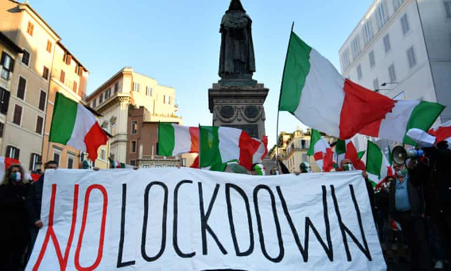 Protesters in Rome take part in a rally last week against the latest government restrictions to stem the rise in coronavirus cases.
