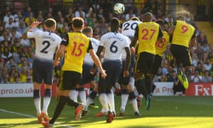 Troy Deeney heads Watford's equaliser.