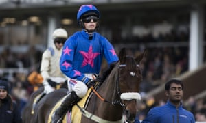 Cue Card being taken down to the start at Haydock on Saturday by his new jockey Harry Cobden.