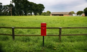 A post box by a field