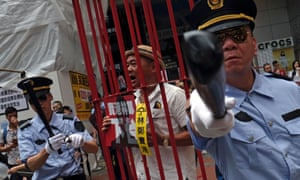 Protesters dressed as Chinese police during a protest to demand authorities scrap a proposed extradition bill with China
