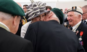 Theresa May meets D-day veterans following a service of remembrance at Bayeux cemetery in Bayeux