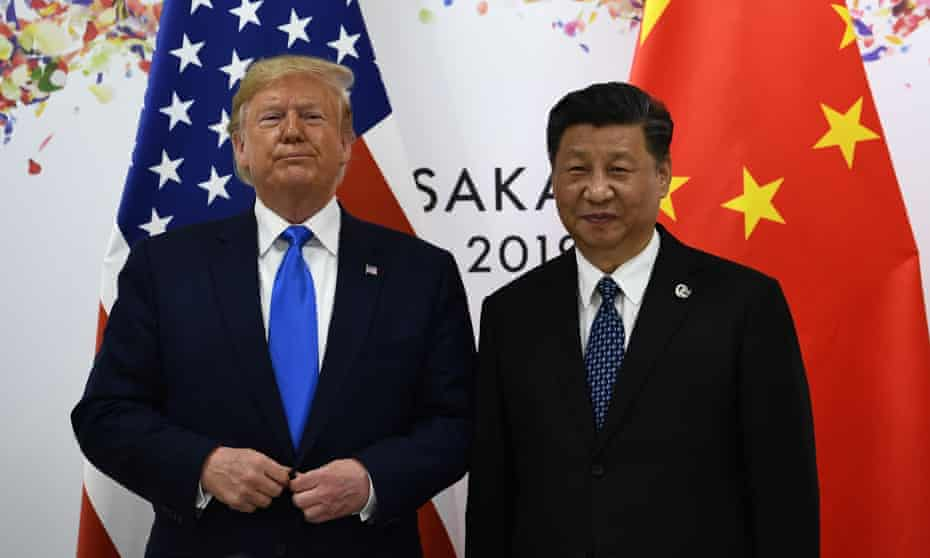 Trump with Xi in June last year. 'Daily events highlight how dangerous Trump is to America and the world.'