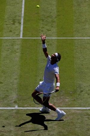 Nadal serves.