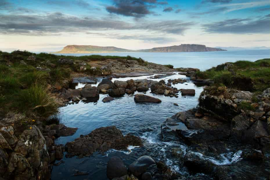 A waterfall sits a distance away from the sea, flows along a small gorge to form a still pool with almost infinity aspect out to sea - looking out eastward to the isle of Eigg. This is the smaller lesser known Cuillin ridge on the Isle of Rum.
