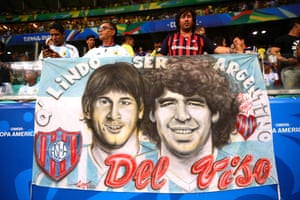 15 June 2019, Argentina v Colombia, Arena Fonte Nova.Salvador.Messi and Maradona banner, the GOAT debate rages every day with Argentinians.