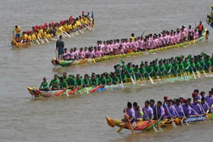 Participants row their dragon boats during the Water Festival on the Tonlé Sap River