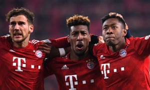 David Alaba (right) celebrates scoring Bayern Munich's third goal with Kingsley Coman, scorer of the other two, and Leon Goretzka (left) who scored an own goal after 13 seconds against Augsburg