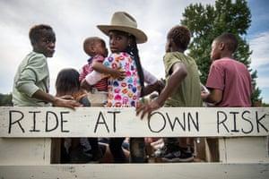 Children wait for a trail ride to begin in Tillatoba