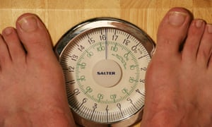 Man on weighing scales