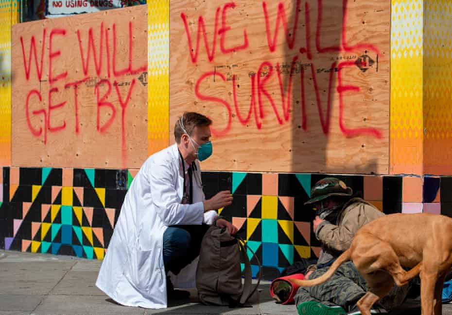 Stuart Malcolm, a doctor with the Haight Ashbury Free Clinic, speaks with homeless people about the virus in March.