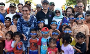 Local children and students on the island of Bangka after receiving their free goggles